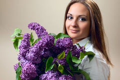 The beautiful woman with lilac. The beautiful woman with spring bouquet of lilac Stock Image