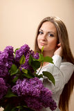 The beautiful woman with lilac Stock Images
