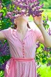 Beautiful woman on lilac Stock Photo
