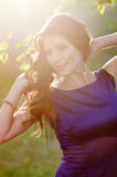 Beautiful woman in lilac dress walking on the meadow Stock Photos