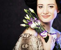 Beautiful woman with lilac  flower Stock Photography