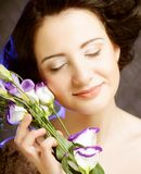 Beautiful woman with lilac  flower Royalty Free Stock Photo