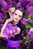 Beautiful woman among lilac Royalty Free Stock Image