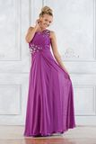 Beautiful  woman in lilac long dress in white interior. Royalty Free Stock Photos