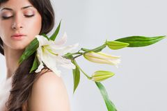 Beautiful woman with lily Stock Photos