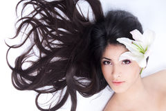 Beautiful woman with lily Stock Images