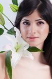 Beautiful woman with lily Stock Photography