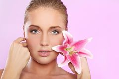 Beautiful woman with lily flower Stock Images