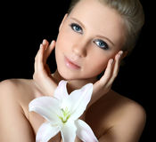 The beautiful woman with lily flower Stock Photo