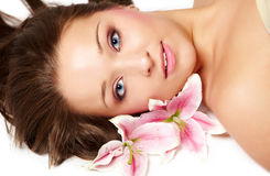Beautiful woman with lily flower Royalty Free Stock Images