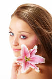 Beautiful woman with lily flower Royalty Free Stock Image
