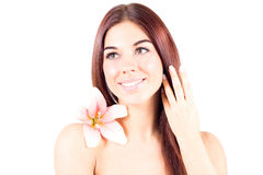 Beautiful woman with lily smiling with teeth and toching her hair. SPA treatment. Stock Image