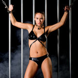 Beautiful woman in lingerie in bondage style Stock Photos