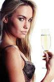 Beautiful woman in lingerie drinking champagne Royalty Free Stock Image