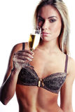 Beautiful woman in lingerie drinking champagne Stock Image