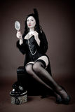 Beautiful woman in lingerie with hand mirror Royalty Free Stock Photography