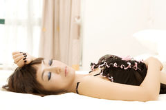 Beautiful woman in lingerie lying bed Royalty Free Stock Images