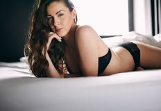 Beautiful  woman in lingerie lying on bed Royalty Free Stock Images