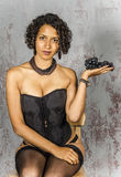 Beautiful woman in lingerie mulatto eat fruit Royalty Free Stock Images