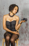 Beautiful woman in lingerie mulatto eat fruit Stock Photos