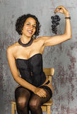 Beautiful woman in lingerie mulatto eat fruit Royalty Free Stock Photo