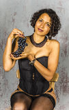 Beautiful woman in lingerie mulatto eat fruit Royalty Free Stock Image