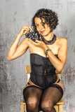 Beautiful woman in lingerie mulatto eat fruit Stock Photography