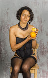 Beautiful woman in lingerie mulatto eat fruit Royalty Free Stock Photos
