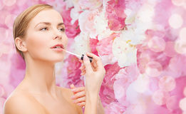 Beautiful woman with lipgloss Stock Image