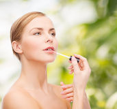 Beautiful woman with lipgloss Royalty Free Stock Image