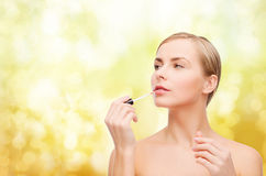 Beautiful woman with lipgloss Royalty Free Stock Photo