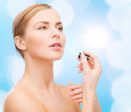 Beautiful woman with lipgloss Royalty Free Stock Photos