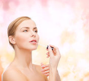 Beautiful woman with lipgloss Stock Photo