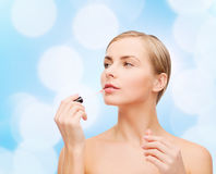 Beautiful woman with lipgloss Royalty Free Stock Photography