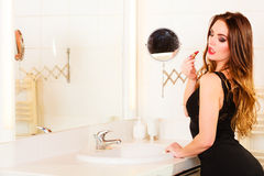 Beautiful woman with lipstick in bathroom. Royalty Free Stock Photos