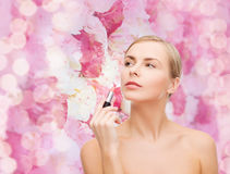 Beautiful woman with lipstick Stock Images