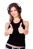 Beautiful woman listen to the music in her headphones Stock Photos