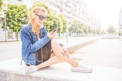 Beautiful woman listening music with headphone Royalty Free Stock Images