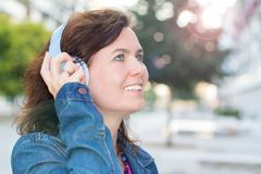 Beautiful woman listening music with headphone royalty free stock photography