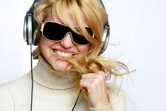 Beautiful woman listening music in headphones Royalty Free Stock Photography