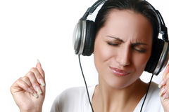 Beautiful woman listening music in headphones Royalty Free Stock Photo