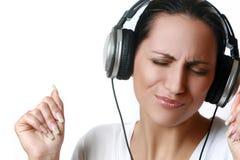 Beautiful woman listening music in headphones Royalty Free Stock Photo
