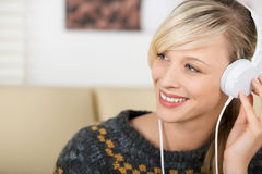 Beautiful woman listening music on headphones Royalty Free Stock Image