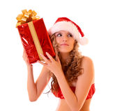 Beautiful woman listening to the gift Stock Image