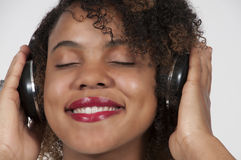 Beautiful Woman listening to Headphones Royalty Free Stock Image