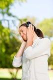 Beautiful woman listening to music Royalty Free Stock Photos