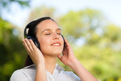 Beautiful woman listening to music Stock Images