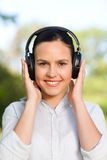 Beautiful woman listening to music Royalty Free Stock Images