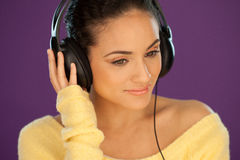 Beautiful woman listening to music Stock Image