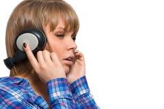 Beautiful woman listening to music on headphones. Stock Photo
